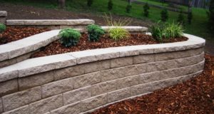 Completed Plant Bedding with Mulch on a Retaining Wall