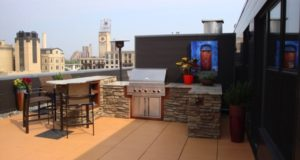 Outdoor Kitchen Faced with Cultured Stone and Granite Countertop