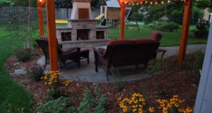 Outdoor fireplace wood storage boxes with Bluestone hearth, mantle, and patio in Bloomington