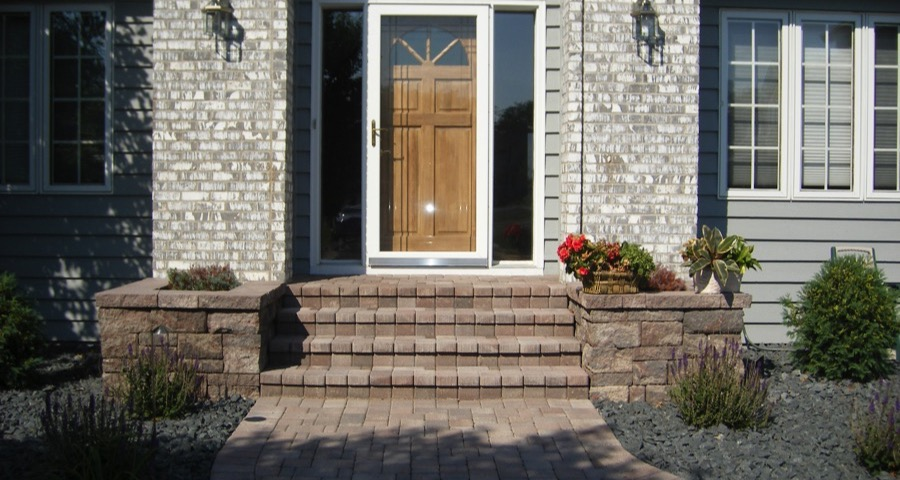 brick pavers laminated on stoop with segmental planters in eden prairie  mn  u2013 apl landscape