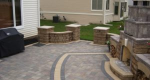 Brick Paver Patio with Free Standing Block Wall and Pillars