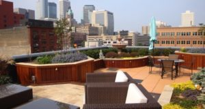 Travertine Patio Surrounded by Rooftop Garden in downtown Minneapolis, MN