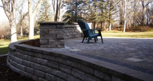 Modular block retaining wall with Tumbled block freestanding wall and pillars with Indiana Limestone tops