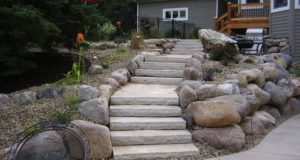 Fieldstone boulder retaining walls with fondulac natural stone steps in Minnetonka, MN