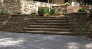 Modular block steps with segmental retaining walls & pillars with Indiana Limestone caps in Minnetonka