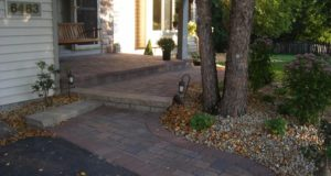 Cobble Patterned Paver Sidewalk with Modular Block Step and Laminated Front Stoop in Eden Prairie, MN