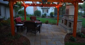 Outdoor Living Space with Bluestone Patio, Pergola and Outdoor Fireplace