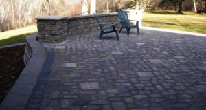 Freestanding wall and pillars with Tumbled paver patio