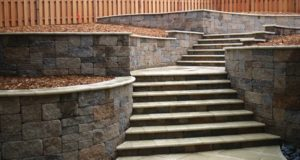 Tumbled retaining walls and steps with travertine cap, Mendota Heights, MN