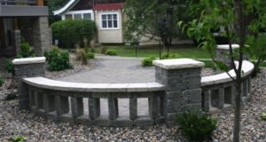 Freestanding sitting wall and pillars with Indiana Limestone caps, Mpls, MN