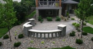 Tumbled freestanding wall and pillars with Indiana limestone caps, Minneapolis, MN